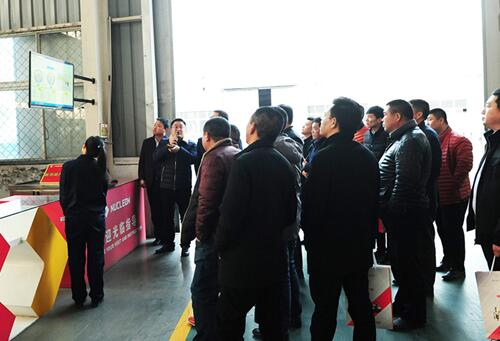 Business elite visiting the company's new products and European crane Internet of things intelligent monitoring system